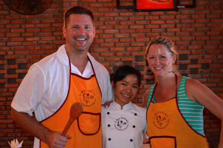 "Our chef- ""Nam"". She's to tiny compared to us!"